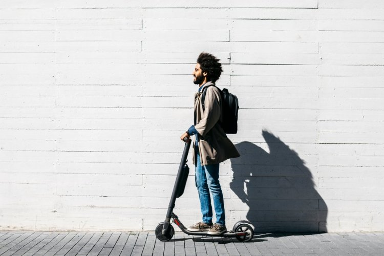 Man on E-Scooter